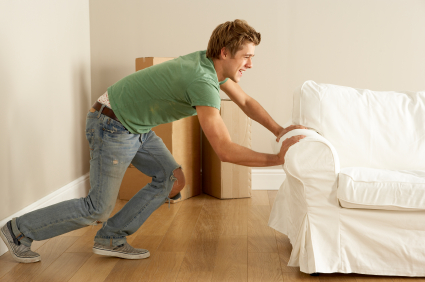 young man moving sofa